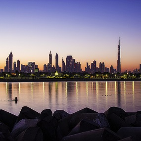 Sunrise behind Dubai skyline